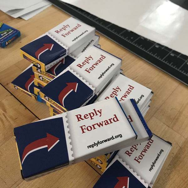 By using the Vinyl printer, Hannah made stickers to personalize boxes of crayons that her participants will use to write and decorate postcards to be sent to the mayor.