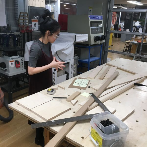 She is using the router, band saw and table saw as well as our handy corner clamps to turn some of our tasty scrap into a solid piece for her experience.