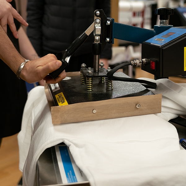 Printing with the high-resolution  Roland VersaCAMM  on heat transfer media and using the heat press to transfer it on your fabric, you can make custom products all day long.