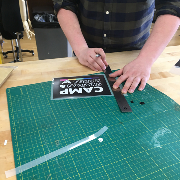 After experimenting with UV printing directly to fabric, Zach is printing on heat transfer sheeting with the vinyl cutter to create tote bags and tee-shirts, and on card stock with the UV printer.