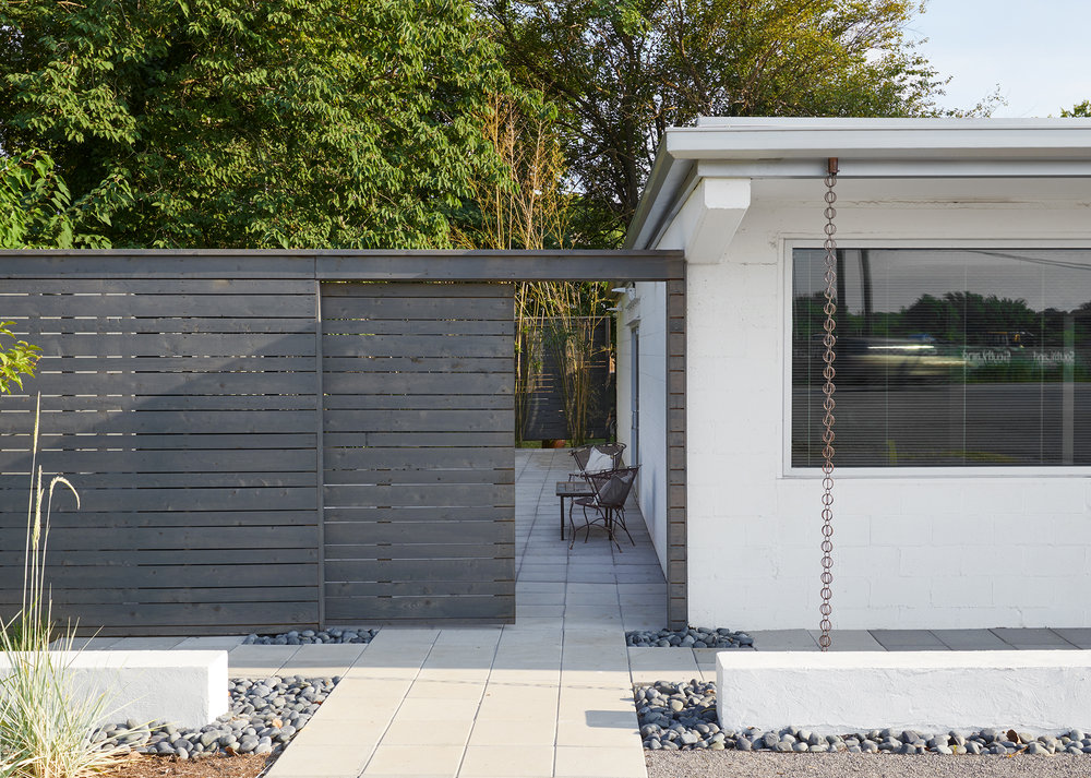 "An existing side ""Lean to"" addition was removed & the space transformed into a Japanese inspired Courtyard"