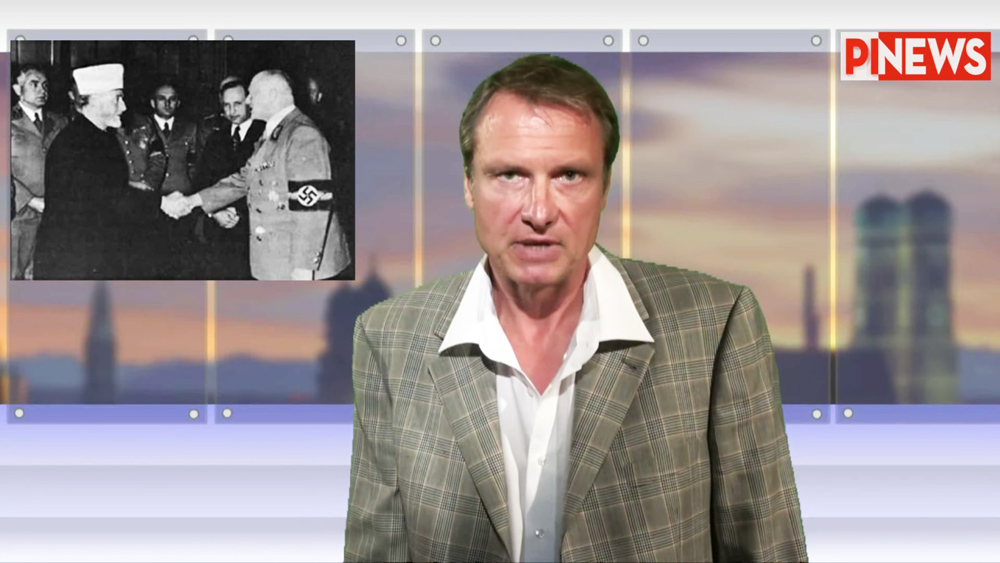 Michael Stürzenberger and the historical photo he was imprisoned for posting on Facebook.(PI News video screenshot/Gatestone Institute)