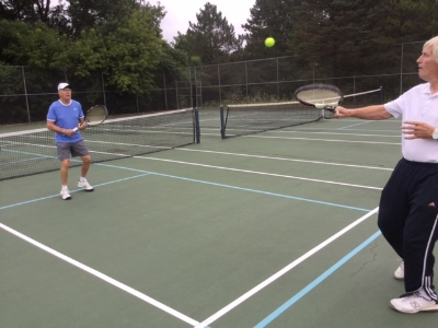 Peter and former high school tennis coach, Fran McGuire, love the game.