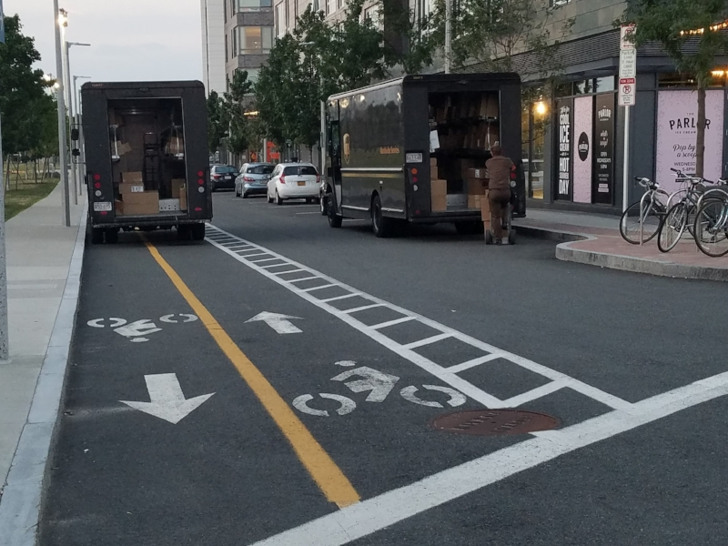 Spurr Street, Allston, MA. UPS driver blocks bike lane with truck.
