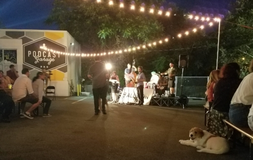 My travels took my to a place with live music and cute dogs. I taught someone the basic steps to Cha Cha and I gave some business to a couple locally owned businesses.