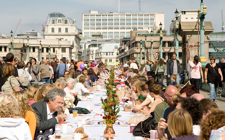 Attendees at a London festival enjoying a meal made entirely of discarded food.