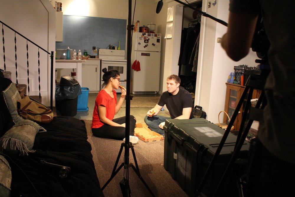 Diana Sanchez and Joshua Cobb on the set of Departure.
