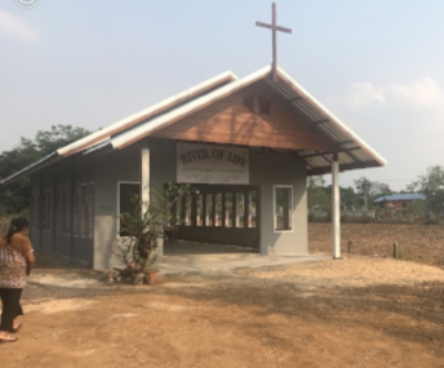 Project 2 - (Nongkee) River of Life Church is located in Burirum Thailand.  On Tuesday January 17, 2018, was the first day of breaking ground, and is still currently under construction. We held our first worship service on Sunday February 11, 2018.  God is using this church in a mighty way! A man gave his life to the lord while doing construction on the church ( the little house with the blue roof in the background is his home). Lead Pastors: Pastor Oui and his Wife