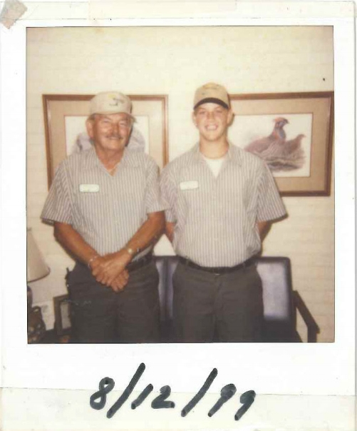 Trey with his maternal grandfather, Dick Parker. Mr. Parker also worked in the family business raising pullets.