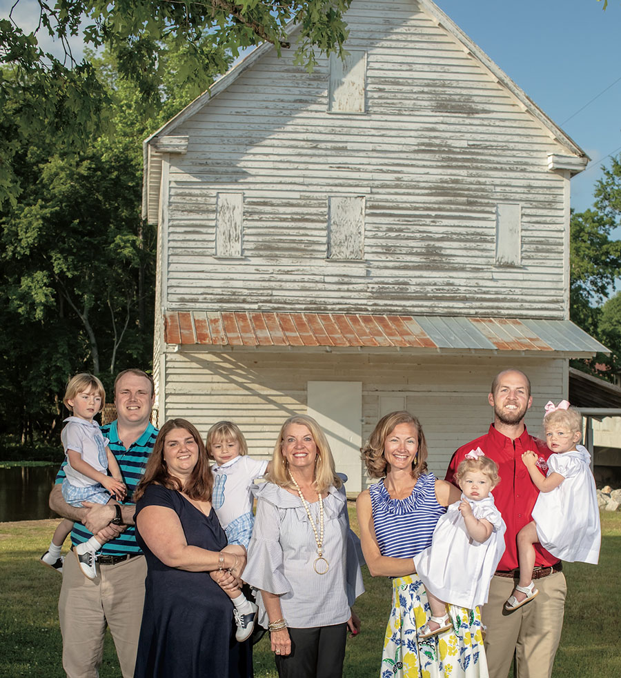 The Braswell Family gathers in front of the original mill site at Boddie's Mill. Scott was unable to join for the photo, but was sorely missed!  Photo by: Michael D. Tedesco/Farm Flavor Media