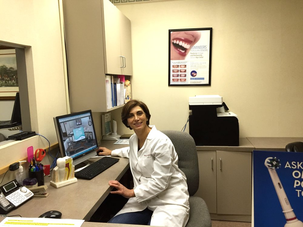 "Randa Hawatmeh, DMD in her West County Office   ""Be confident in your smile, it's contagious"""