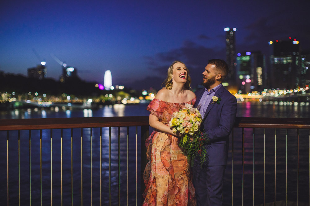 Bride and groom with Brisbane city lights at night