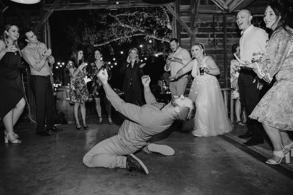 Guests dancing at wedding reception in barn at Spicers Hiddenvale