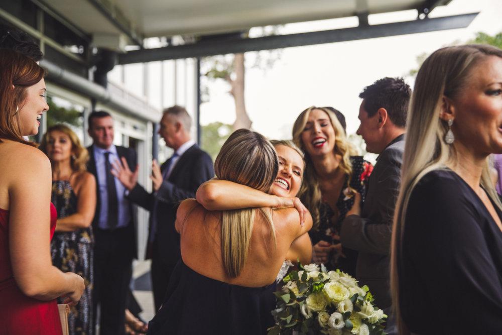 Congratulations hugs at wedding at Victoria Park Golf Complex