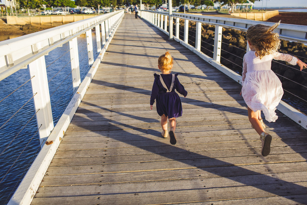 Children running on pier