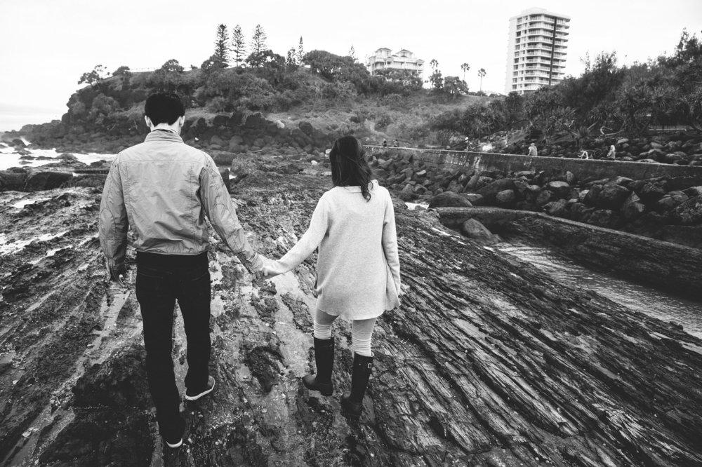 Couple walking hand in hand on Gold Coast beach