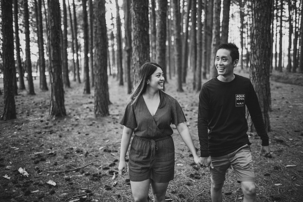 couple walking through gold coast forest