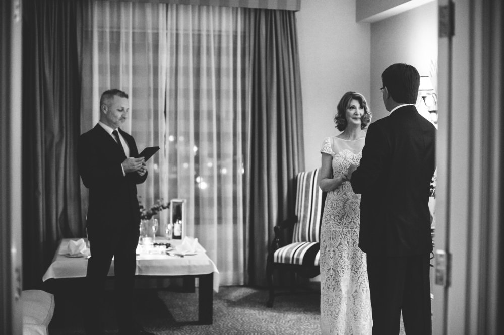 bride and groom saying their vows in hotel elopement