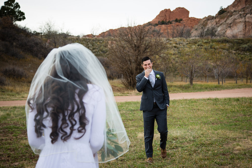 Even though many of the traditional elements were left out, the couple still wanted to capture the tender moment of a first look, and  Rock Ledge Ranch  was the perfect backdrop.