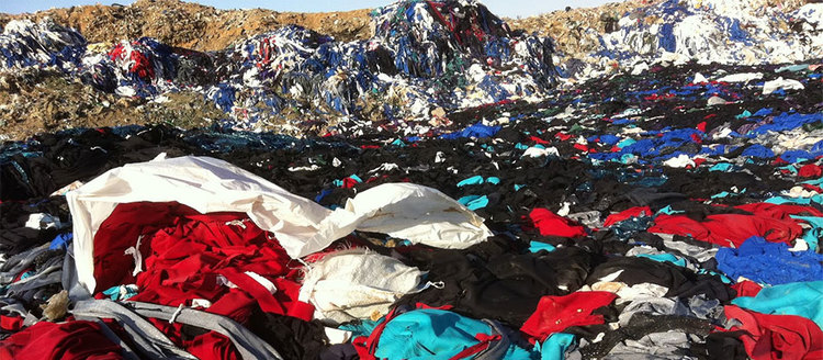 Discarded clothing and other textiles in a landfill outside of Damascus. Photo by  Mohammad J. Taherzadeh
