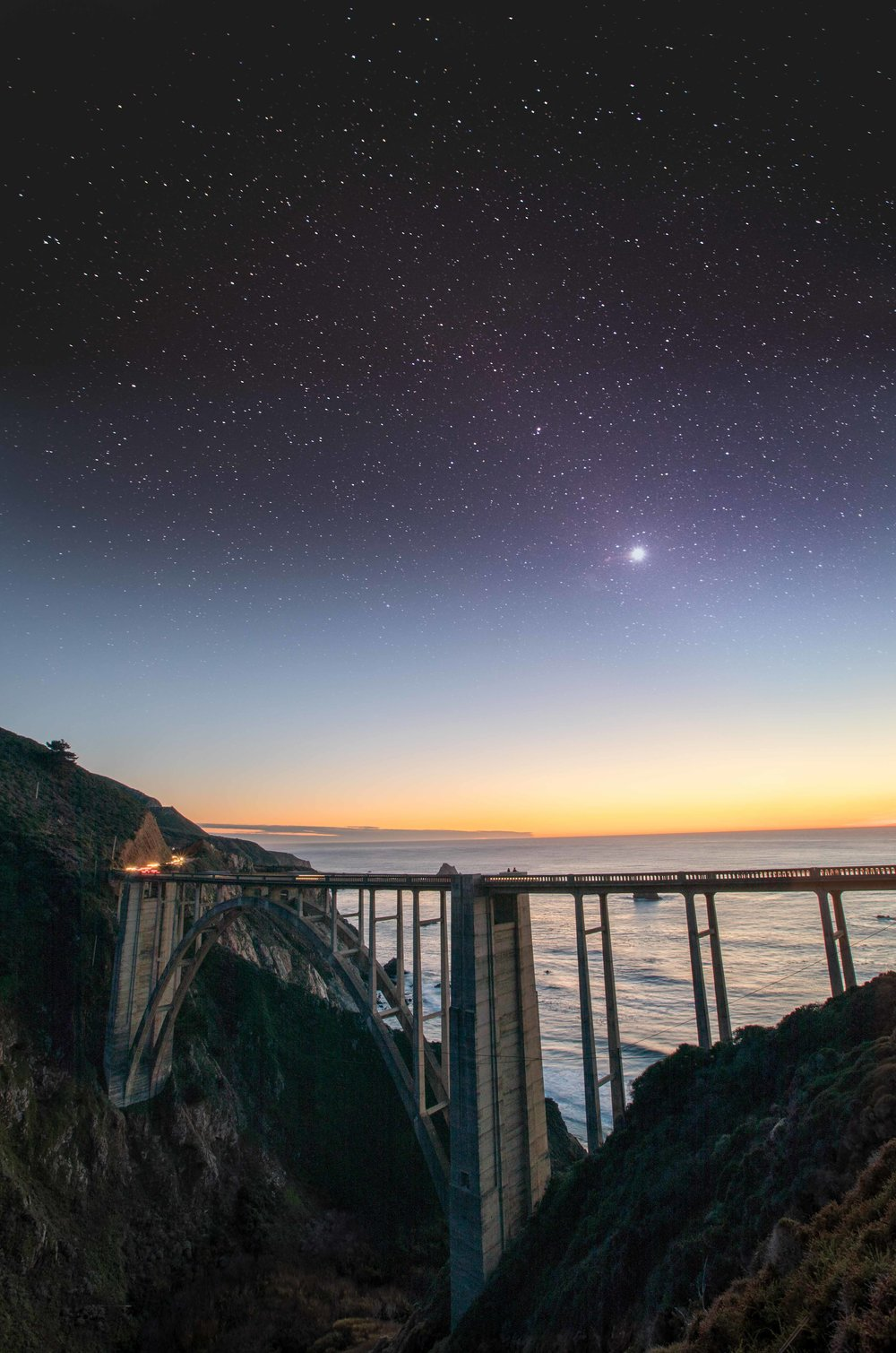Photo of the Bixby Bridge, just south of Monterey. I took this shot twice, once before sunset and once after it got dark. I then combined the two images.