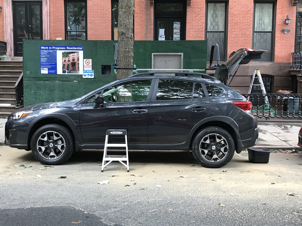 A 2' 2-step Werner ladder also fits neatly in the Subaru Crosstrek 2018 cargo bay. No more standing-on-the-wheel-well acrobatics and straps for this paddler!