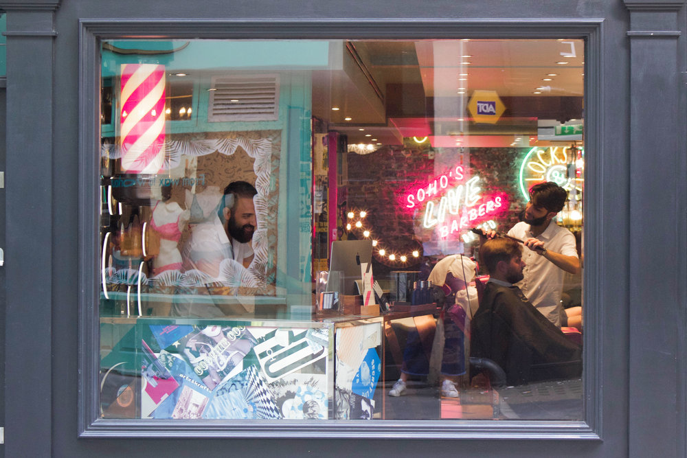 A small barbershop in SOHO. They looked so happy and the guy at the desk even smiled and waved at me while I stood on the opposite side of the street, creepily photographing him...