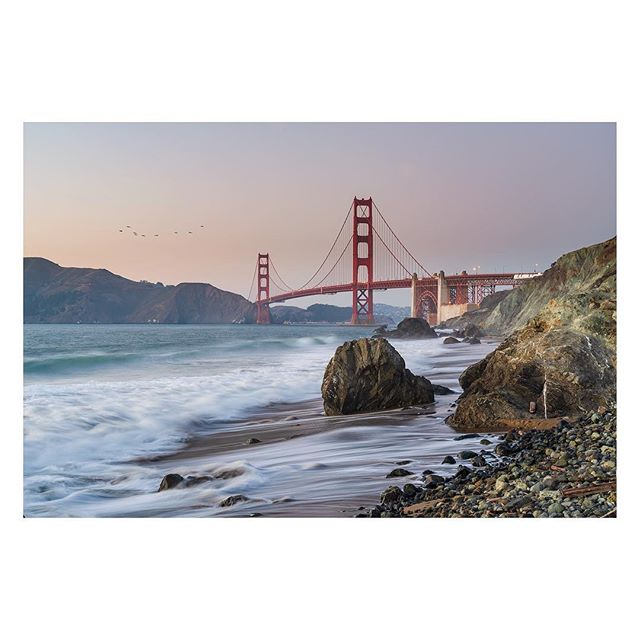 Golden Gate | Take 1,000,000,001 🌁 Blog post up - see link in Bio. 🌁 Limited Edition prints available 🌁 It's been done before - like a billion times, before. Here is the 1,000,000,001 shot ;-) - I took a guess as to where to shoot from using Google Maps, grabbed an uber, and I was on my way. The 10-minute hike down to Marshalls's Beach was teasing me with excitement. There were some kids hanging out and a couple other photographers but otherwise, not too crowded. I quickly picked a vantage point, grabbed a composition started shooting, and just soaking it all in. I loved every minute of it...the pounding waves, the sound of the birds, and the salty breeze. As I said, it's been done before, but now its been done by me! #getoutside . . . . . #travelmore #westcoastvibes #way2ill #awesome_earth #landscapepainting #goldengatebridge #water_brilliance #limitededition #artofvisuals #fineartphotography #landscape_lover #agameoftones #bridges_of_our_world #sanfrancisco #architectureporn #bayareaphotography #westcoast #coastalvibes #officedecor #instaawesome #ndmagazine #sonyalpha #sonya7riii #longexposure_shots #longexposure #johnguillaume #igshotz #travelandlife #natgeoyourshot