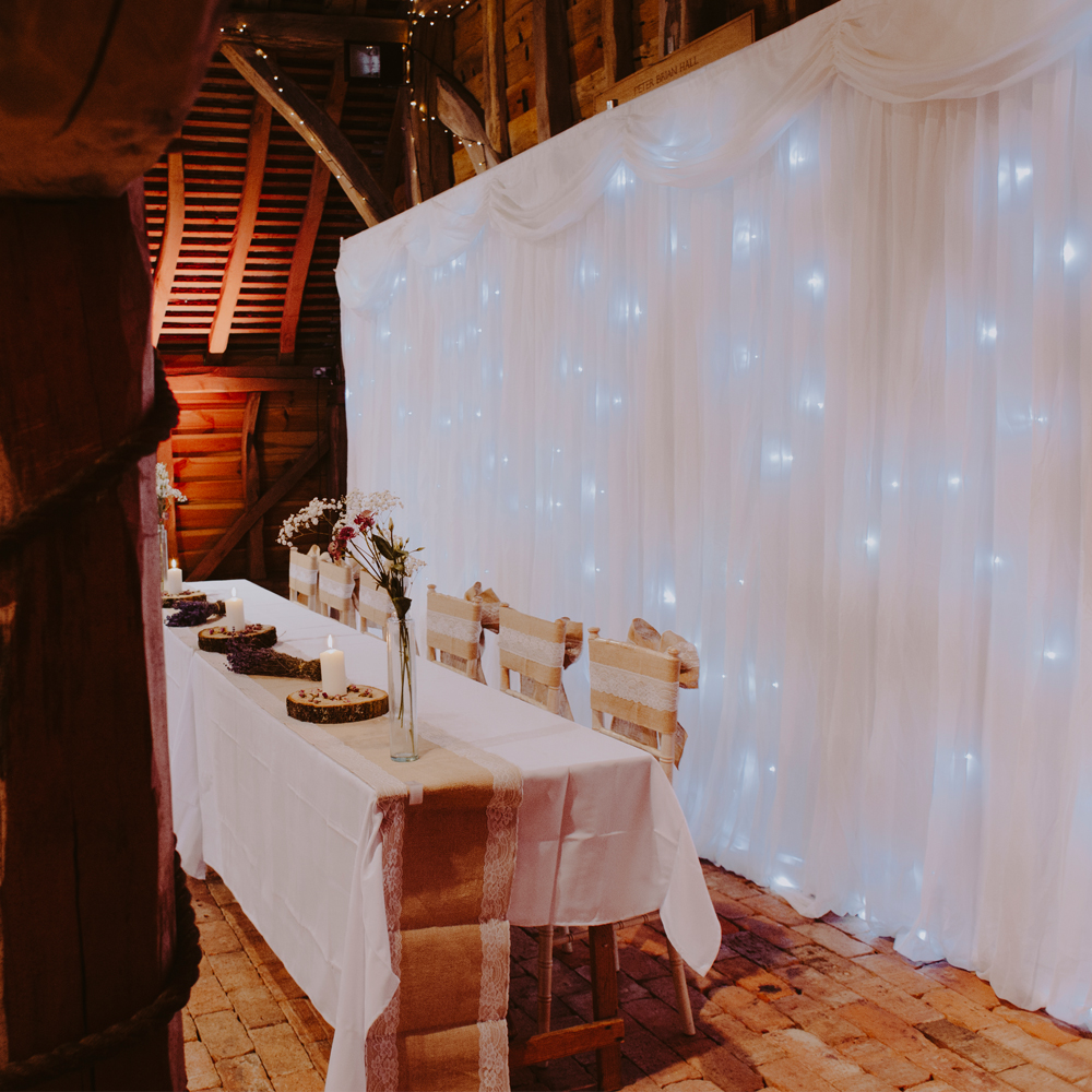 White LED Backdrop: £150   White LED Top Table Skirt - £50