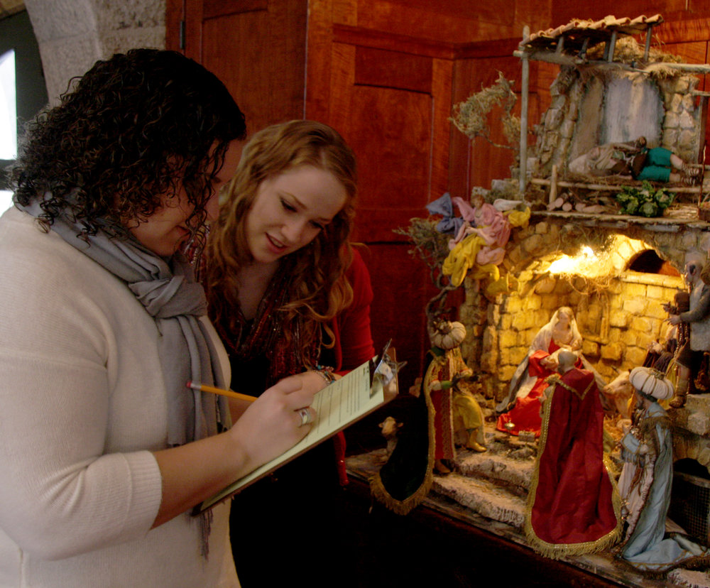 Visitors explore the  World Nativities  exhibition at Glencairn Museum