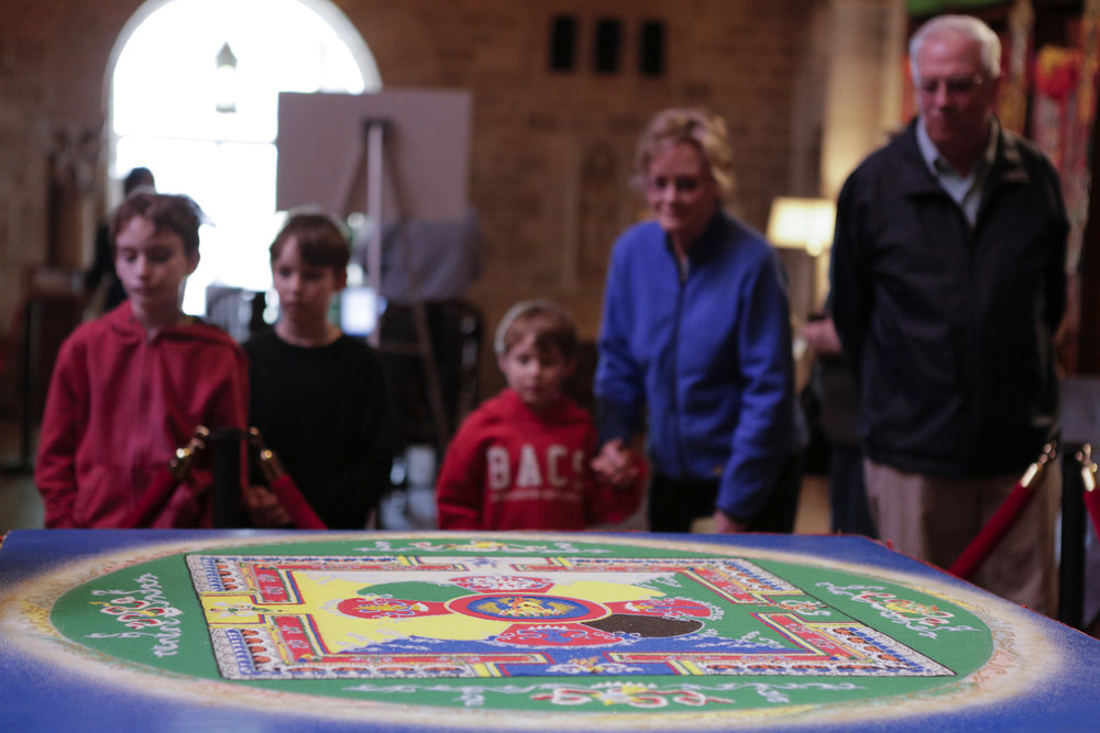 Visitors enjoying a sand mandala at Glencairn Museum