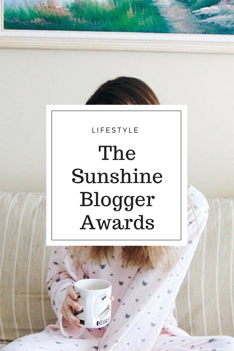 The Sunshine Blogger Awards.png