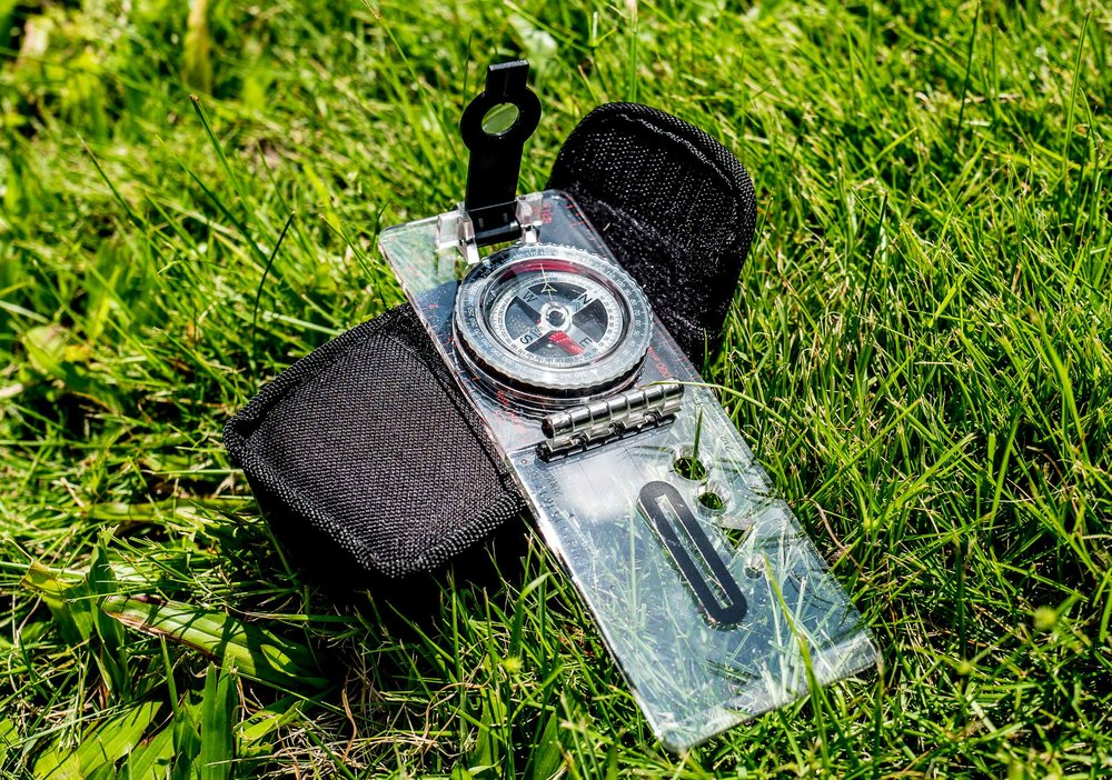 sighting compass - Ok, so in Hong Kong it would be a pretty strange situation where you would need a compass, but it's a good habit to keep one with you and practice using it with a map from time to time.  You can scoop these up just about anywhere for pretty cheap as well so no reason not to keep one in your pack.