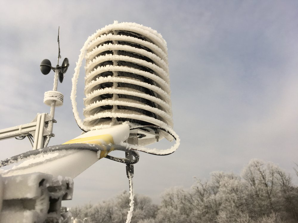 Morning icing covering a BARANI DESIGN weather station in winter