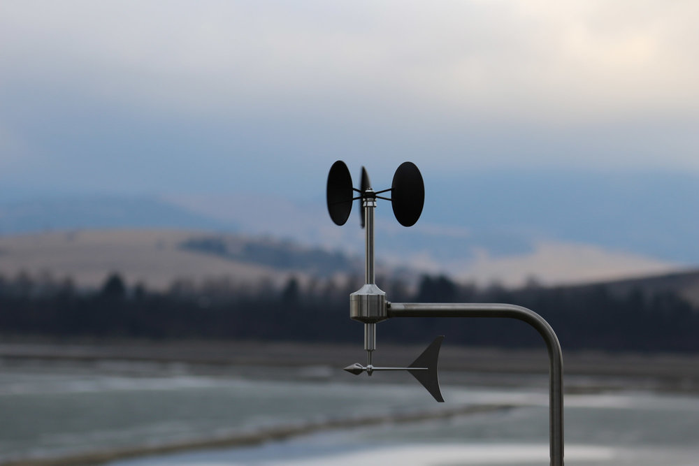 MeteoWind anemometer with mountains & lake shore