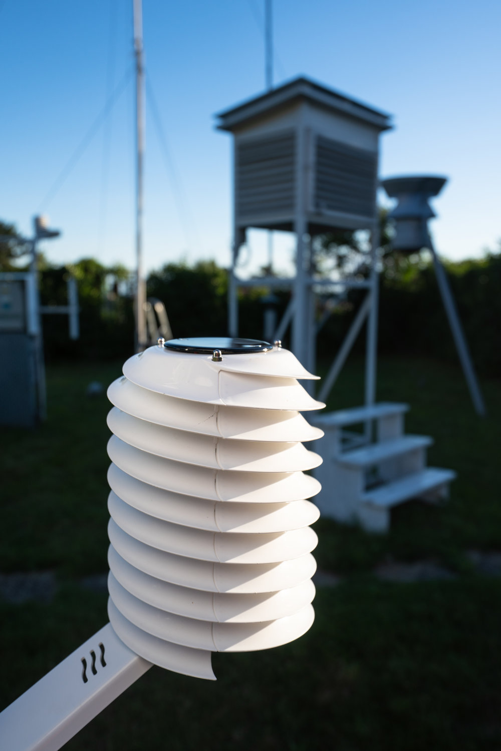 MeteoHelix weather station in a meteo garden of professional meteorological instruments.