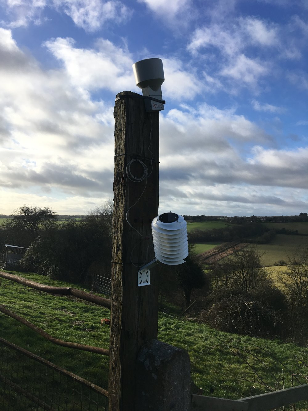 The wrong way to mount the MeteoHelix weather station: They are not level and the MeteoHelix is on the shady-side of the mounting pole which obstructs the sun sensor.