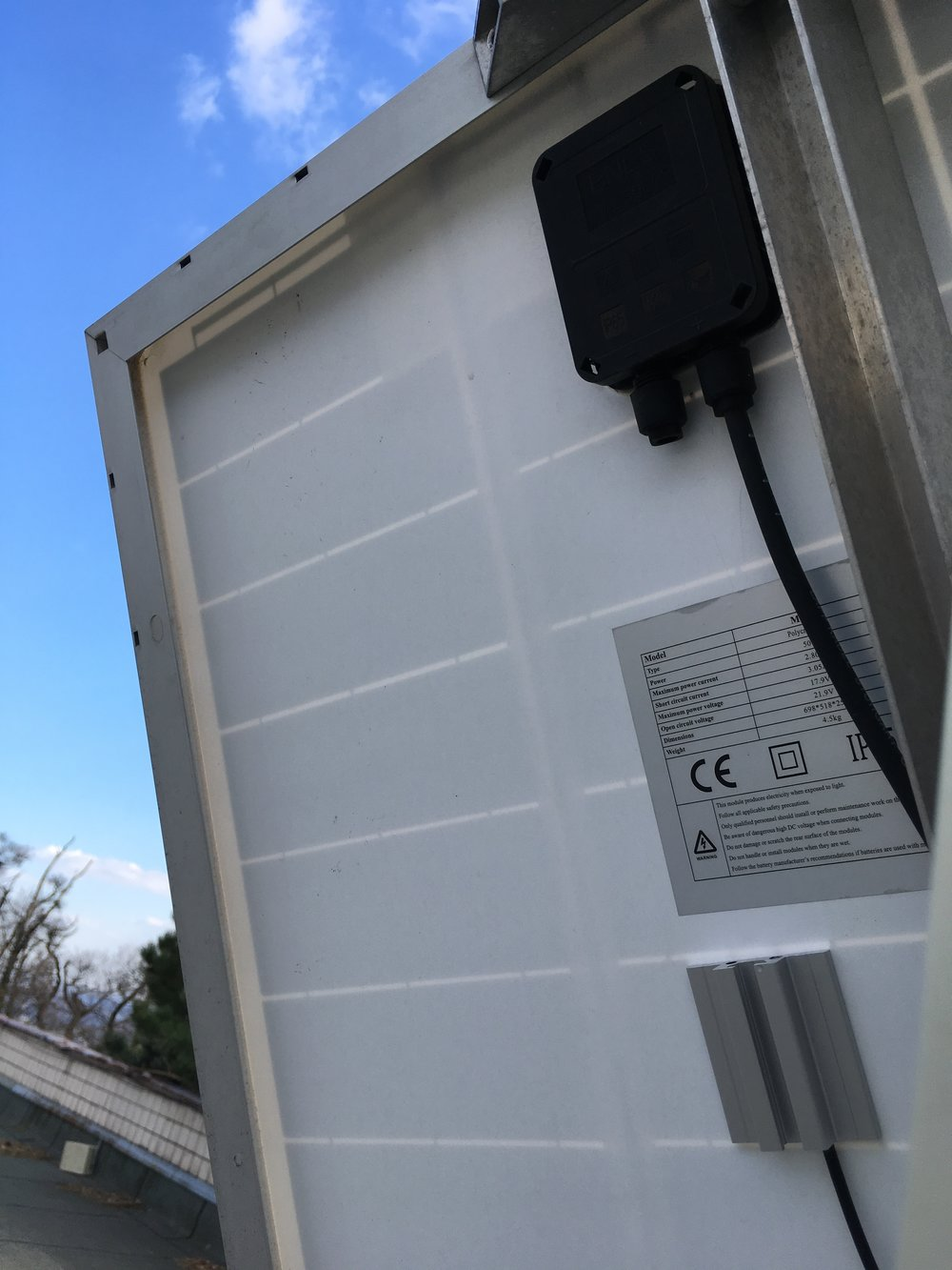 SolarTemp PT100 bonded on the back of a solar panel