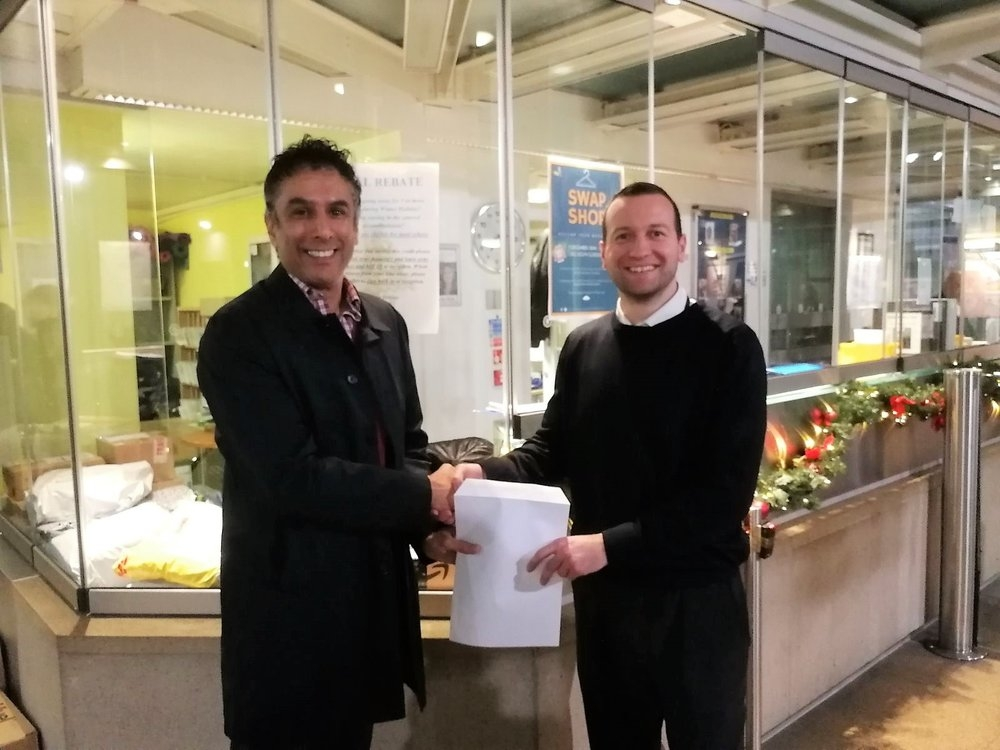 Norbi Receiving the IH Community Award for November from IH Warden, Saeed Zeydabadi- Nejad.