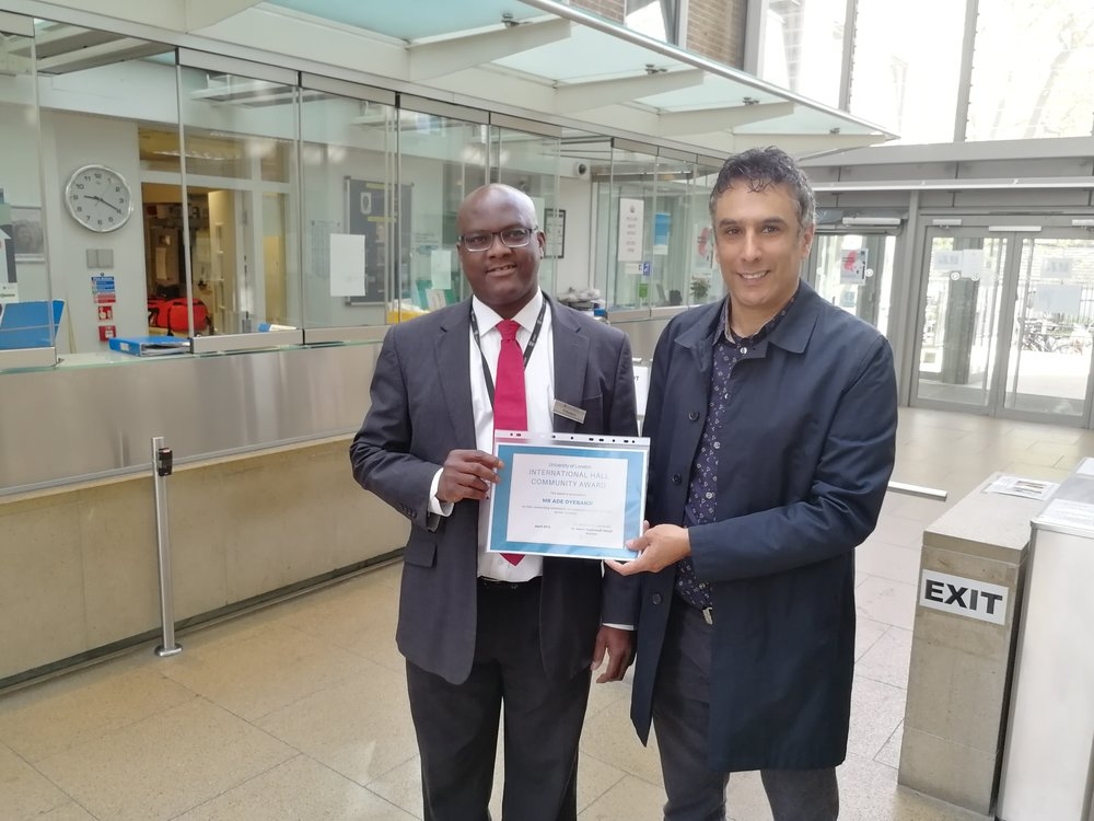 Ade Oyebanji  (one of our amazing receptionists), receiving a community award from our Warden, Dr Saeed Zeydabadi-Nejad.