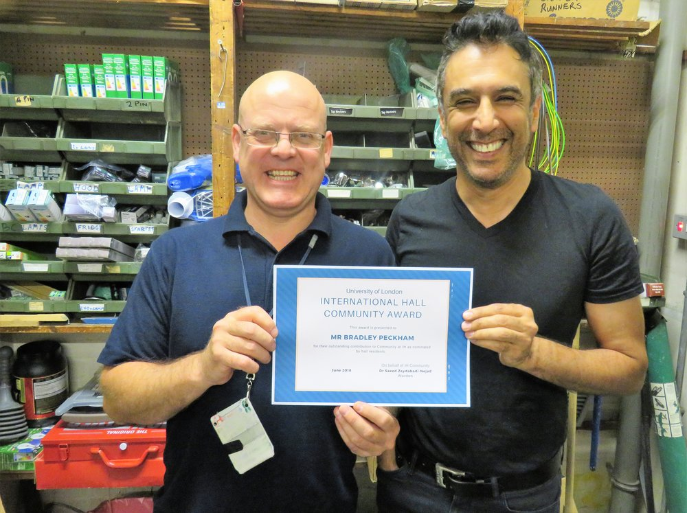 Brad (one of our maintenance staff) receiving a community award from Saeed, International Hall Warden.