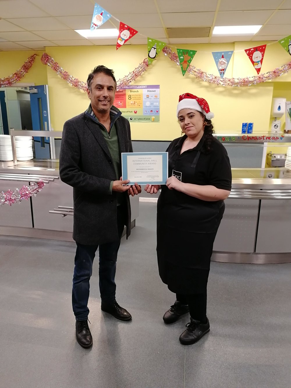 The Warden, Saeed, with December Community Award winner Becci Isaacs.