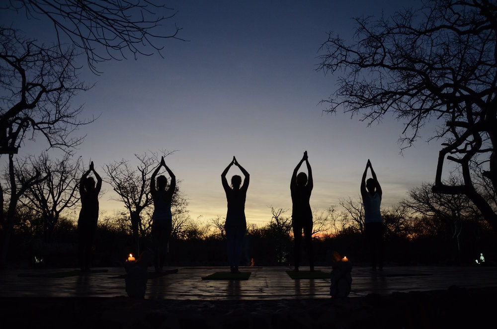 Sunset yoga on our outdoor yoga deck at Etosha Village