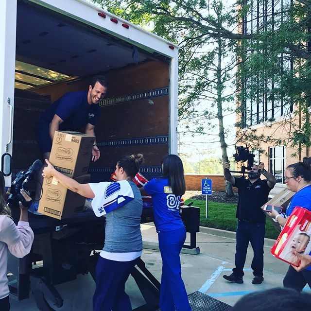 """What a morning! The Diaper Bank received a """"special delivery"""" of 160,000 diapers this morning, donated by Missouri Baptist Medical Center, the @stlouisblues and @huggies ❤️ many thanks to @joeybroadcaster and @louiestlblues for working hard to get that truck loaded and diapers unloaded, wrapped and stocked at the warehouse! The team even took some time to write love notes for the parents who will open those diapers! Thank you!!!"""
