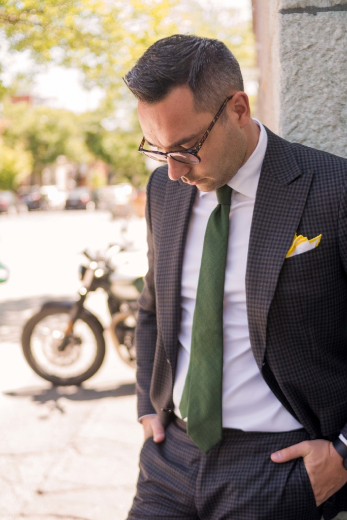 Mix-and-match with colour.  Juggling your priorities while striving to perform at a high standard can seem pretty daunting! Try incorporating light hearted remnants of summer into your suit game, like Nick has done. Nick's a busy, urban gentleman who works hard and loves experimenting with his style. He has paired a canary yellow linen pocket square with a  Canvas  mid-weight wool/cashmere suit in deep khaki.