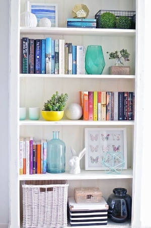 Decluttered shelves for beauty and substance.  (photo Bloglovin.com)
