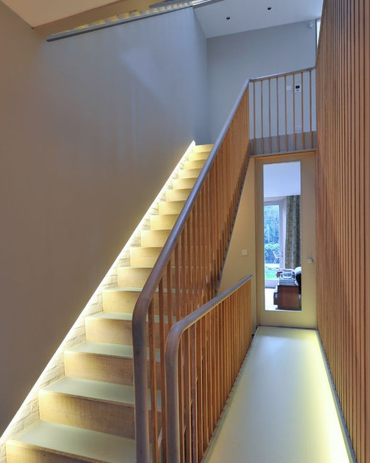 BEAUTIFULLY LIT STAIRS. IDEALLY I'D ADD ANOTHER RAILING ON THE WALL.