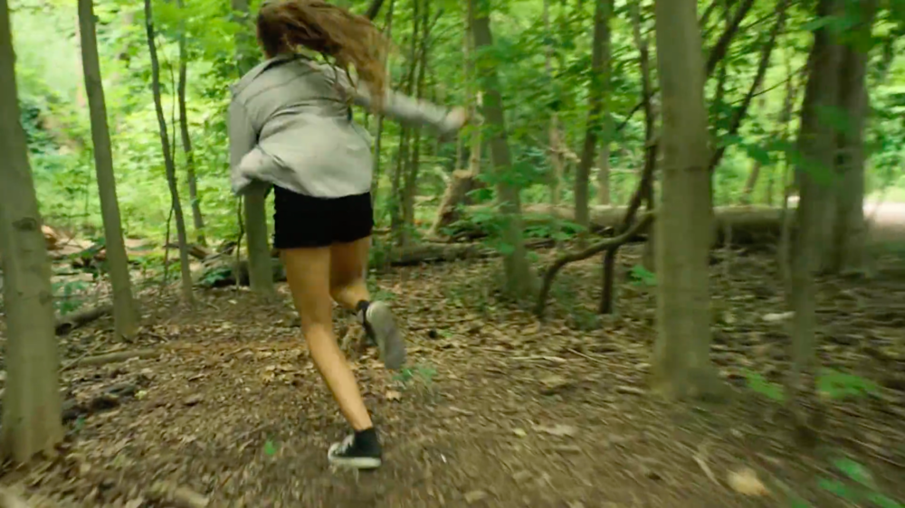 Shot #4 (1:35) - The student is trying to escape her stressors by running away from them in the forest.