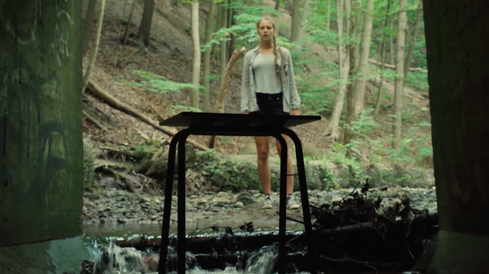 Shot #2 (04:31) - The student is confronted with the trigger of her stress. The emotions that she was attempting to escape from in the forest are now beginning to resurface with the appearance of the desk.