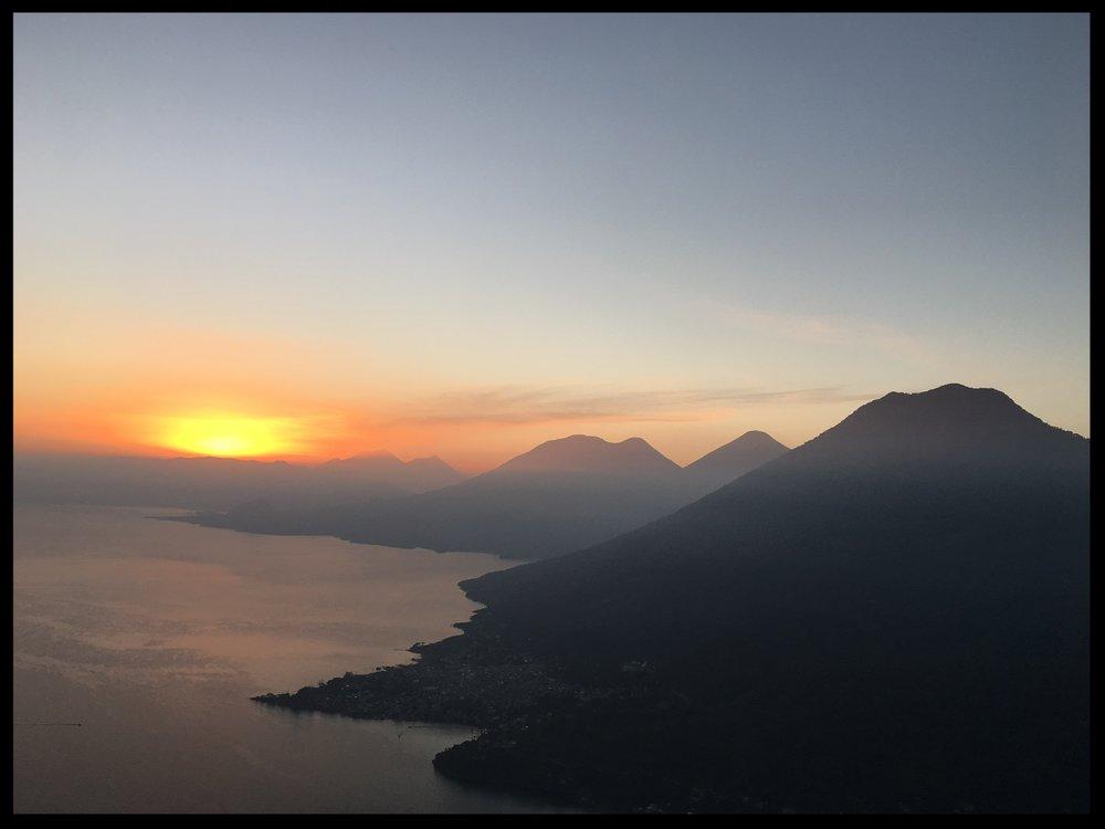 Sunrise over Lake Atitlan, the site of Joyce's WRITE BY THE LAKE workshop.